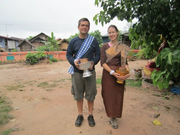 Bringing alms to a temple in Laos